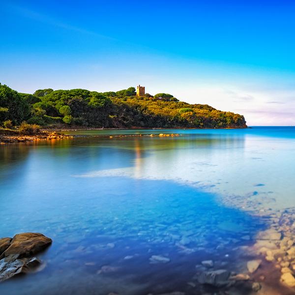 Punta Ala sea, wild beach bay and old tower. Maremma Tuscany, Italy Europe